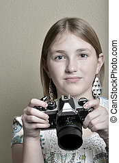 Young Girl Photographer with Vintage Old Camera