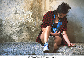 Young girl pierces with syringe and is heroin drug