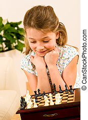 Young girl play chess cute smile