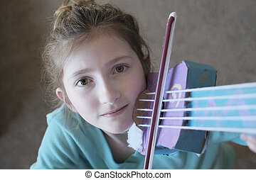 Young Girl Playing a Toy Violin Fun and Beautiful