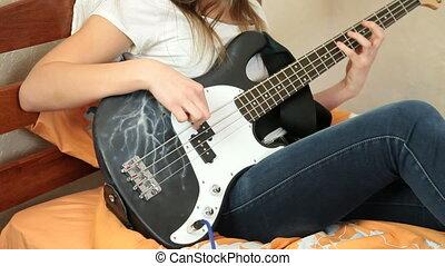 Young Girl Playing Bass Guitar
