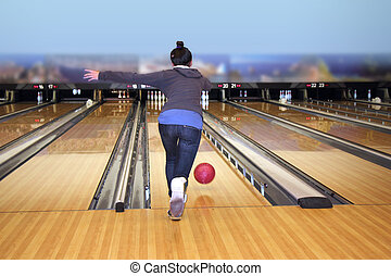 Young girl playing bowling