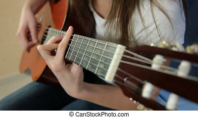 Young Girl Playing Guitar
