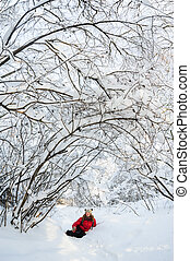 young girl playing in snow