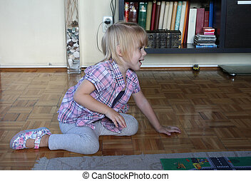 Young girl playing on the floor