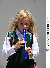 Young Girl Playing the Recorder
