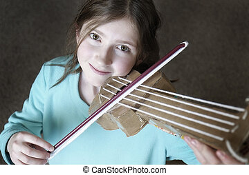 Young Girl Playing Toy Violin