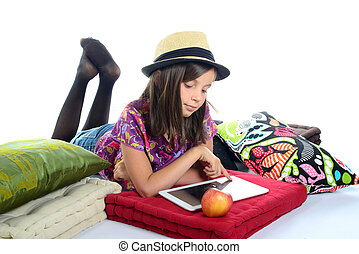 young girl playing with a digital tablet