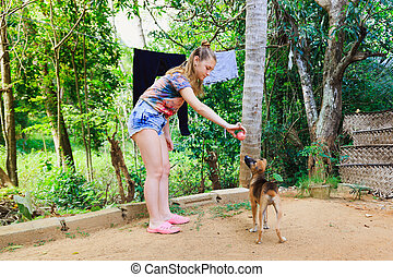 young girl playing with a puppy