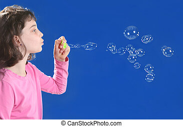 Girl Playing With Soap Bubbles - Young Girl Playing With...