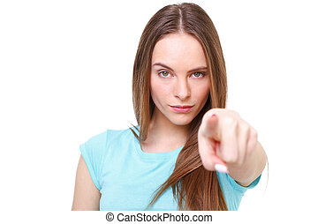 Young girl pointing at you - isolated on white.