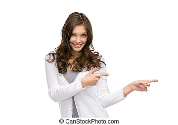 Half-length portrait of young girl pointing hand gesture, isolated on white