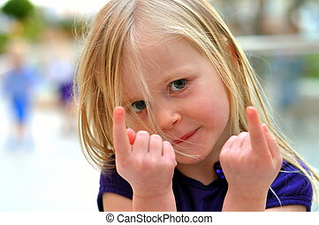 Young girl pointing with fingers