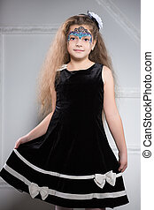 Young girl posing in black dress