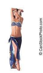 Young girl posing in polka dot bikini with pareo