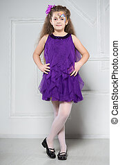 Young girl posing in purple dress
