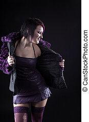 Young girl posing in purple fur coat