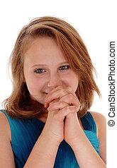 Young girl praying.