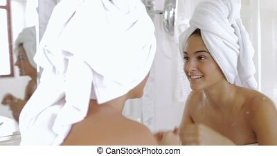 Young girl preparing in front of mirror - Charming smiling...