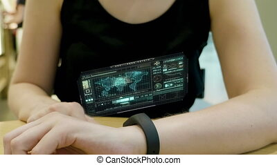 Young girl press on futuristic user interface concept...
