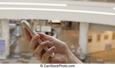 Young girl press on futuristic user interface concept phone....