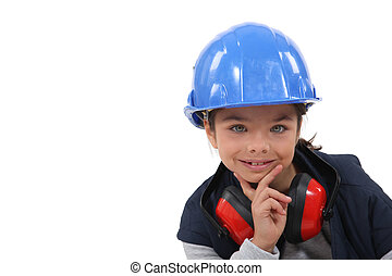 Young girl pretending to be a construction worker