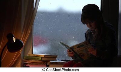 Young girl read the book