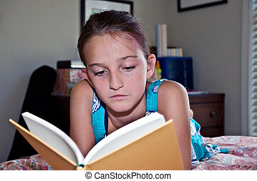 Young Girl Reading a Book in Her Room