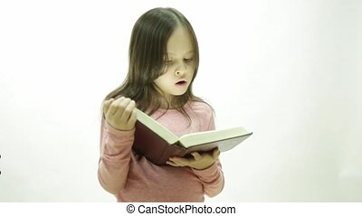 Young girl reading a thick book