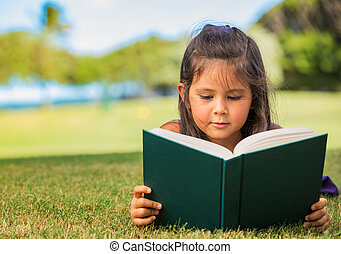 Young Girl Reading - Cute Little Girl Reading Book Outside...
