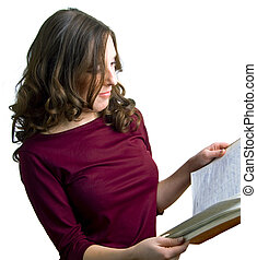 young girl reads a book