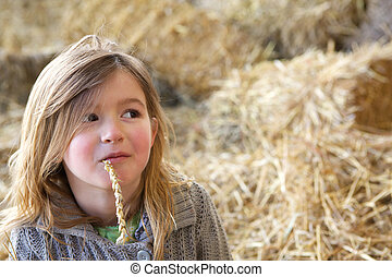 Young girl relaxing at farm
