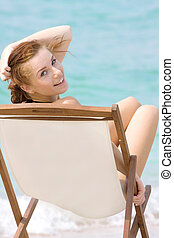 young girl relaxing on beach