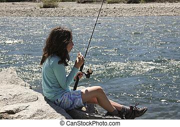 Young Girl Relaxing while Fishing