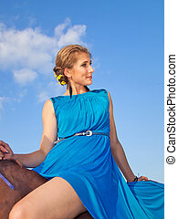 young girl ride on a horse