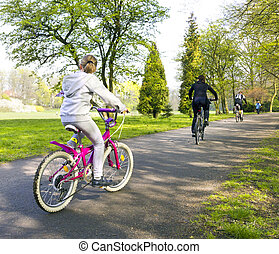 girl riding a bike in park