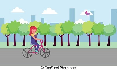 young girl riding bicycle in the city street