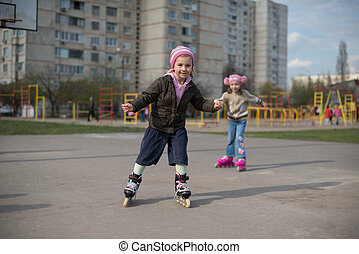Young girl riding on roller skates.