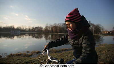 Young Girl Riding the Bike 2