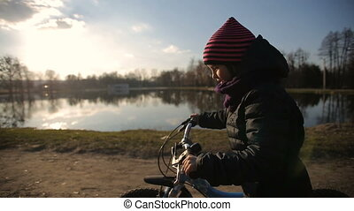 Young Girl Riding the Bike