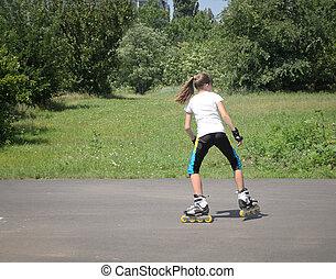 Young girl roller skating