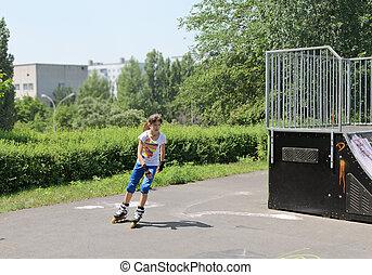 Young girl roller skating in a skate park