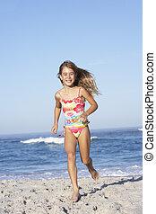 Young Girl Running Along Sandy Beach