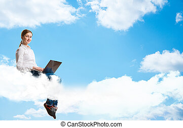 young girl running in the clouds with a laptop