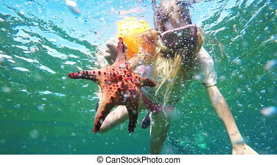 Young girl scuba diver - Girl scuba diver holding a...