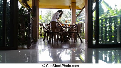 Young Girl Serving Food For Breakfast On Summer Terrace, Woman Making Preparations For Meal Outdoors In Morning Sunlight