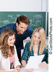 Young girl sharing a document with her friends - Young...