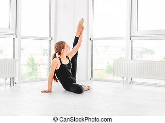 Young girl showing flexibility
