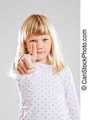 Young girl showing thumbs up sign