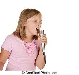 young girl singing karaoke on white